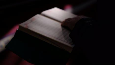 Hands-Holding-Quran-In-Sunlight