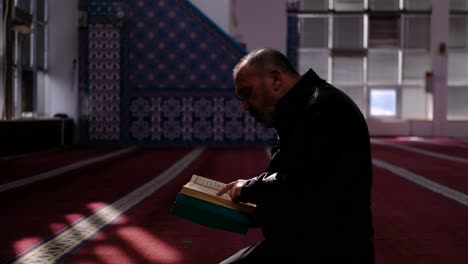 Middle-Age-Man-Reads-Quran-In-Mosque-3