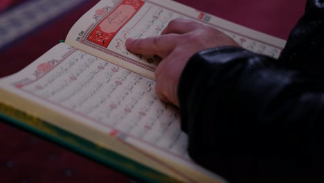 Reading-Muslim-Holy-Book-In-Mosque
