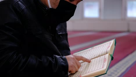 Reading-Muslim-Holy-Book-The-Quran-In-A-Mosque