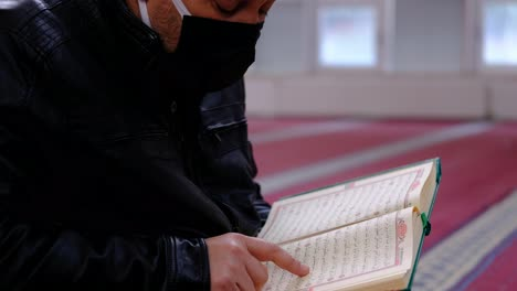 Muslim-Reading-Holy-Book-The-Quran-In-A-Mosque