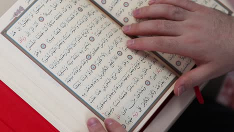 Young-Muslim-Reading-Quran-In-Mosque-1