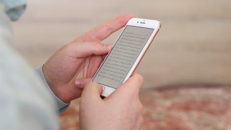 Muslim-Man-Reading-Quran-On-Mobile-Phone