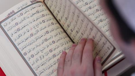 Close-Up-Of-Young-Man-Reading-Quran