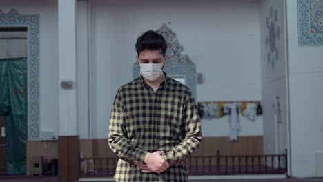 A-Young-Man-Praying-In-The-Mosque-During-A-Pandemic