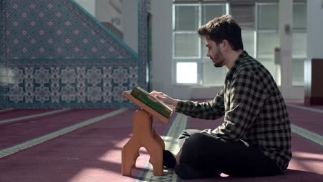 Muslim-Man-Reading-Quran-In-A-Mosque