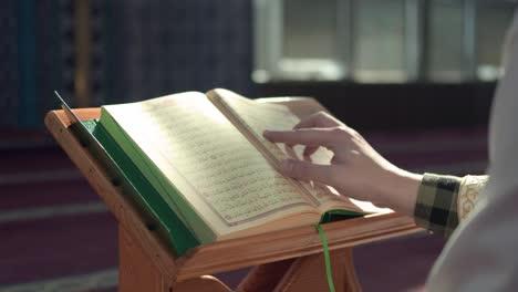 Muslim-Man-Reading-Quran-Mosque-2