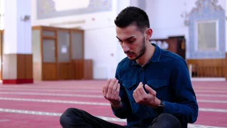 Man-Raising-His-Hands-And-Praying-In-A-Mosque-1