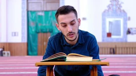 Man-Reads-The-Quran-In-Mosque
