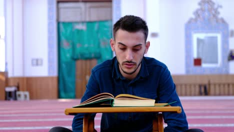 Young-Muslim-Recites-The-Quran-In-Mosque