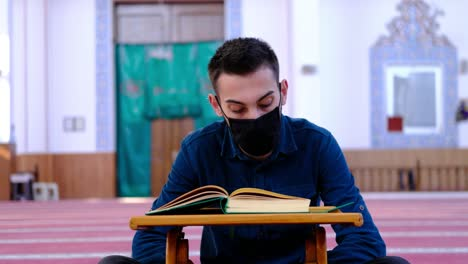 Young-Man-Wears-A-Mask-And-Reads-The-Quran-In-Mosque