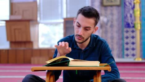 Young-Muslim-Recites-The-Quran-In-A-Mosque