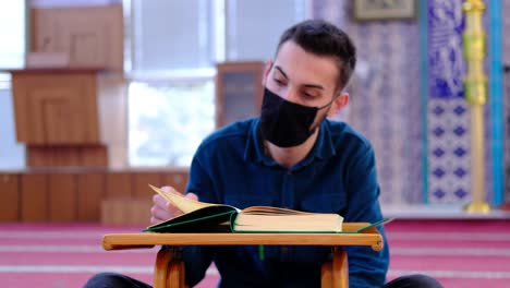 Young-Muslim-Weaing-A-Mask-Reads-The-Quran-In-Mosque