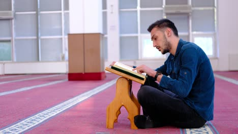 Young-Muslim-Man-Reciting-The-Quran-In-Mosque