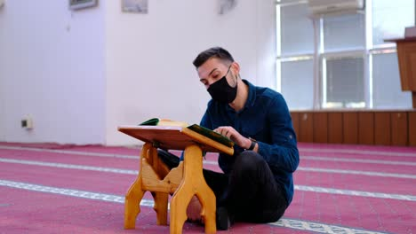 Man-With-Mask-Reading-The-Quran-In-Mosque