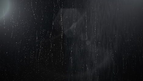 Cinematic-background-with-rain-on-dark-wall-and-motion-camera