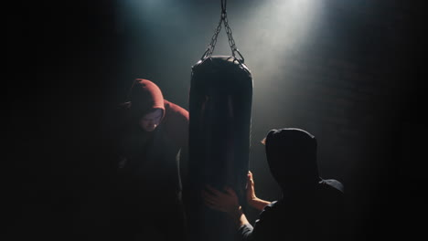 Boxer-trains-with-partner-in-the-gym