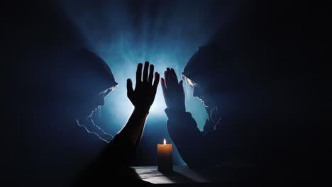 Two-men-in-hoodies-pray-in-the-dark