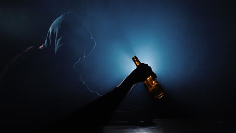The-silhouette-of-an-alcoholic-with-an-empty-bottle-in-his-hand