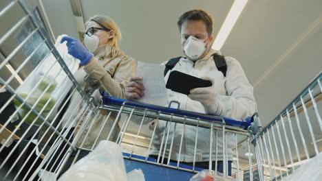Young-Couple-Buys-Fruit-In-Supermarket-During-Coronavirus-Epidemic