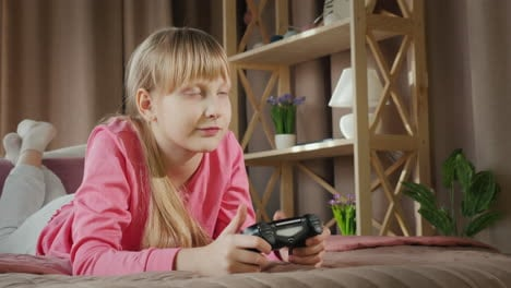 Blonde-girl-plays-video-games-on-the-console