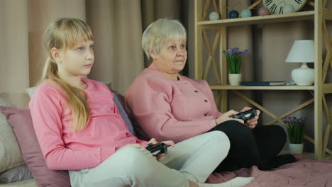 Grandmother-and-granddaughter-play-video-games-together-2