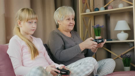 Grandmother-and-granddaughter-play-video-games-together-4