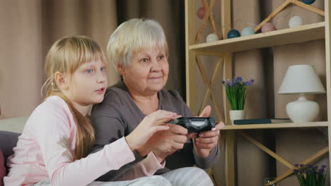 Grandmother-and-granddaughter-play-video-games-together-5