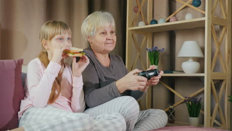 Grandmother-and-granddaughter-play-video-games-together-6