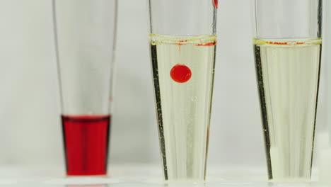 Technician-drop-blood-in-test-tube-7