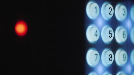 A-person-enters-a-pin-code-on-a-backlit-keyboard-1