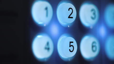 A-person-enters-a-pin-code-on-a-backlit-keyboard-4