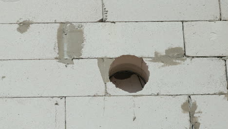 Drilling-Into-Thick-Wall-Of-House
