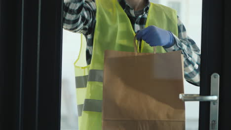 The-Male-Courier-Brings-A-Package-Of-Groceries-To-The-Order-Door