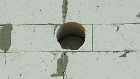 Drilling-Into-Thick-Wall-Of-House-1