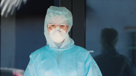 Doctor-In-Protective-Suit-And-Mask-Shows-Stop-Hand-Sign