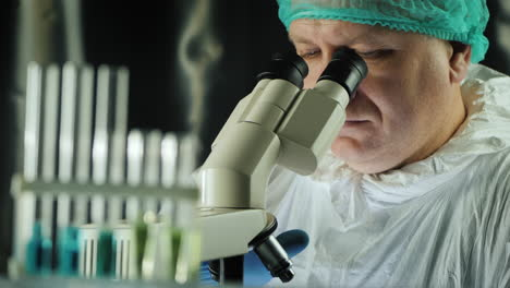 Test-tubes-in-the-lab-as-a-man-works-with-a-microscope-2