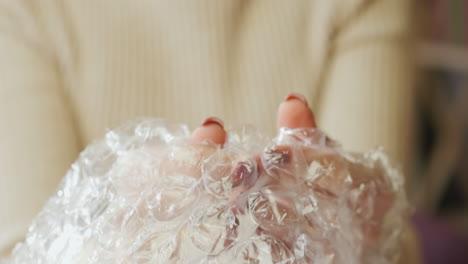 A-woman-pops-bubble-wrap-3