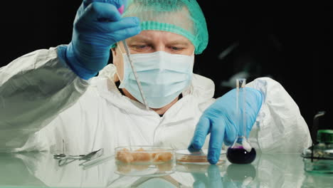 Man-tests-chicken-meat-samples-checks-for-chicken-flu-virus