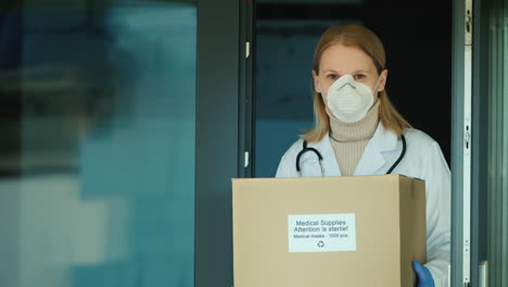Portrait-Of-A-Doctor-With-A-Box-Of-Protective-Medical-Masks