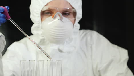 A-man-in-a-biological-protection-suit-works-in-a-lab