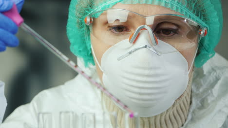 A-woman-in-protective-clothing-works-in-a-laboratory