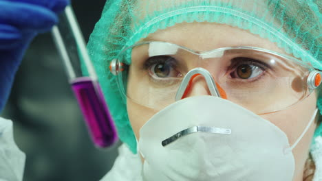 Female-researcher-works-in-the-laboratory-with-test-tubes-and-chemicals-3