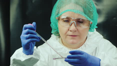 A-woman-performs-a-blood-test-in-the-lab