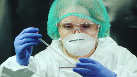 Woman-lab-technician-does-blood-test-in-lab