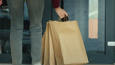 Courier-Brings-Packages-Of-Groceries-To-The-Doorstep-Of-The-House