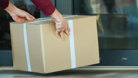 Courier-Delivers-Parcel-To-The-Door-Of-The-House