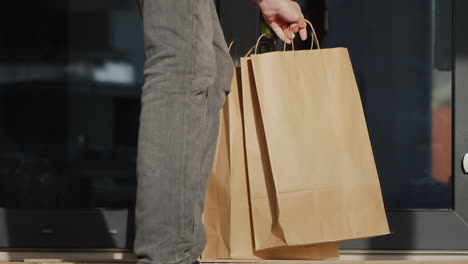 Courier-Delivers-Food-Bags-To-The-Doorstep-Of-The-House