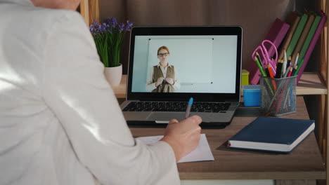 Female-Student-Studies-At-Home-Near-Laptop-University-Online-Concept