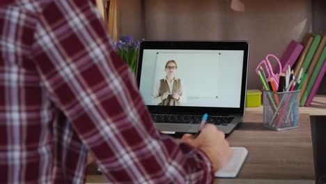 Male-Student-Doing-Homework-Lessons-Learning-Online